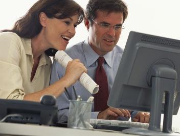 man-woman-enthusiastic-at-pc-monitor